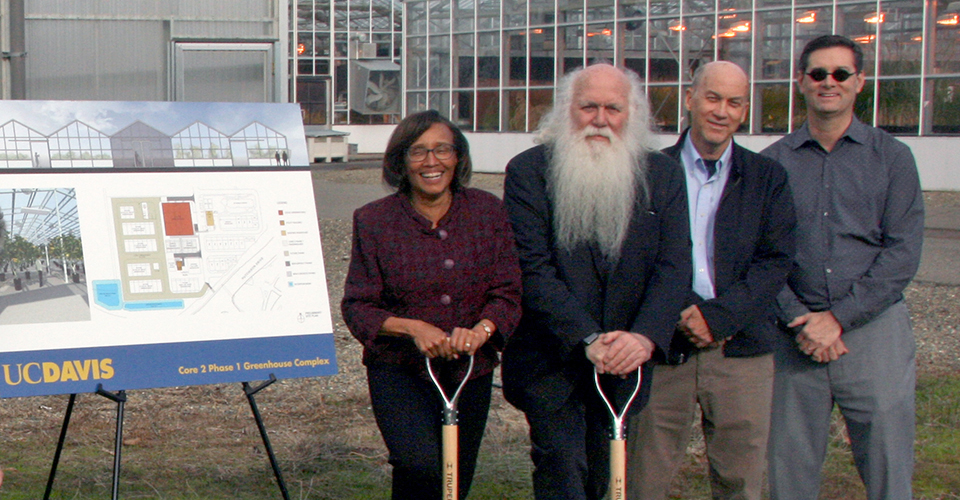 From left: Helene Dillard, dean of the UC Davis College of Agricultural and Environmental Sciences; Howard Shapiro, chief agricultural officer at Mars, Inc.; distinguished UC Davis professor and plant geneticist David Mackill and Jim Carrol, Associate Vice Chancellor for Design & Construction Management look forward to construction of new greenhouses where researchers can cacao under any number of climatic conditions.