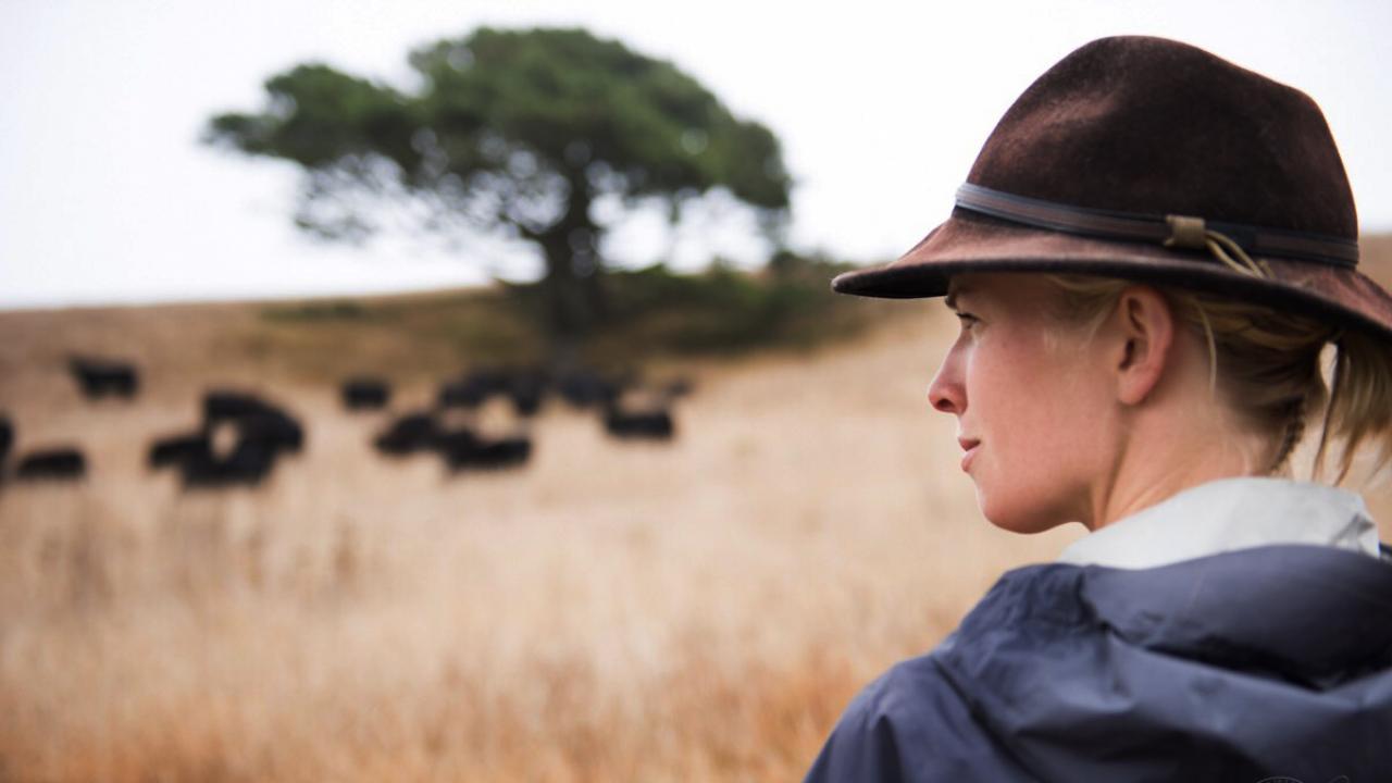Female rancher in field