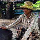 Cambodian farmer with pig